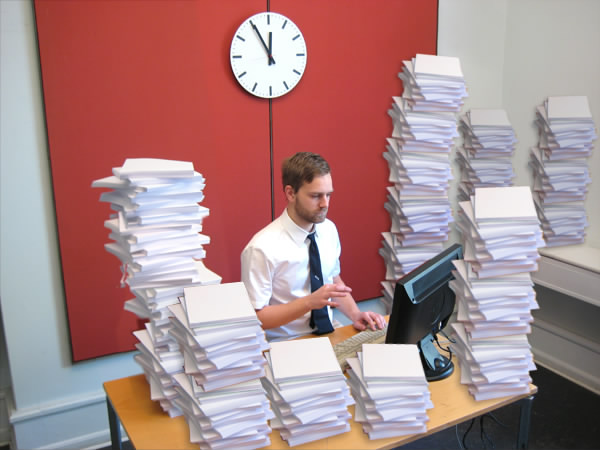 Picture of a bunch of paperwork on a desk